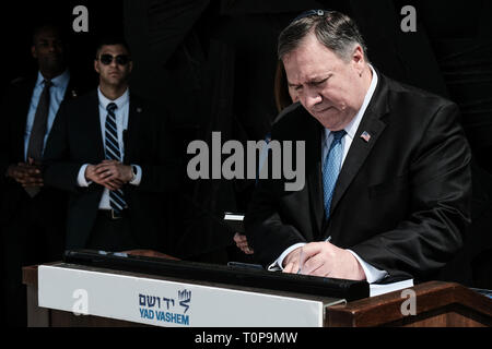 Jerusalem, Israel. 21st March, 2019. Secretary of State of the United States of America, MICHAEL MIKE POMPEO (R), visits Yad Vashem World Holocaust Remembrance Center touring the 'Flashes of Memory - Photography during the Holocaust' exhibition, partaking in a memorial ceremony in the Hall of Remembrance and signing the guest book. Pompeo's visit to Israel comes ahead of a meeting between Trump and Netanyahu planned for 25th March, 2019, in Washington, perhaps signaling the U.S. Credit: Nir Alon/Alamy Live News - Stock Photo