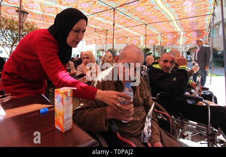 March 21, 2019 - Gaza City, Gaza Strip, Palestinian Territory - Palestinian elderly take part during a celebration on the occasion of Mother's Day, at el-Wafa elderly nursing home in Gaza city, on March 21, 2019. Mother's Day is a celebration honoring the mother of the family, as well as motherhood, maternal bonds, and the influence of mothers in society. It is celebrated on various days in many parts of the world, most commonly in the months of March or May. It complements similar celebrations honoring family members, such as Father's Day, Siblings Day, and Grandparents Day (Credit Image: © - Stock Photo