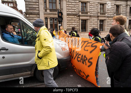 Glasgow, Scotland, UK. 21 March, 2019. A  'Blue Wave' demonstration by the Extinction Rebellion climate change protest group saw protesters make blue footprints, made from water-soluble paint, across George Square to the City Chambers. The peaceful protest briefly held up traffic. The Group aims to highlight threat of rising water levels in the River Clyde and of global climate change. Credit: Iain Masterton/Alamy Live News - Stock Photo