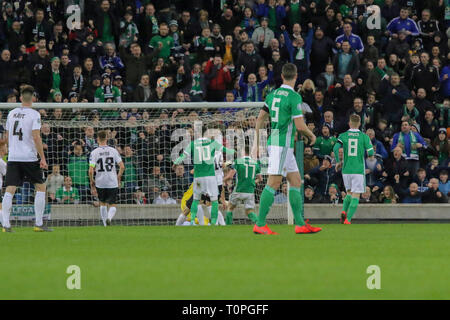 Belfast, UK. 21st Mar 2019. National Football Stadium at Windsor Park, Belfast, Northern Ireland. 21 March 2019. UEFA EURO 2020 Qualifier- Northern Ireland v Estonia. Action from tonight's game. Paddy McNair (17) heads over. Credit: David Hunter/Alamy Live News. - Stock Photo