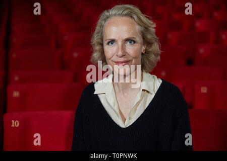 Hamburg, Germany. 18th Mar, 2019. Juliane Köhler, actress, is stitzting at the Abaton cinema during a photo session for the German-French film project 'Eden'. The six-part is broadcast in May on arte and in the first. Credit: Georg Wendt/dpa/Alamy Live News - Stock Photo