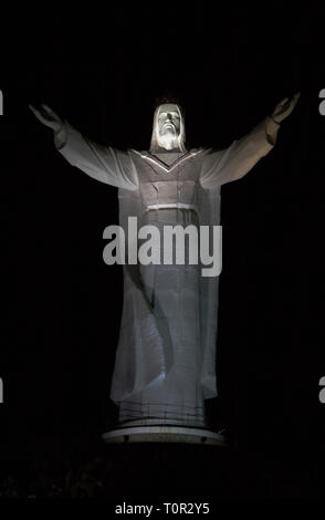 A large, lightened up, statue of Jesus Christ the King, Świebodzin, Poland. - Stock Photo