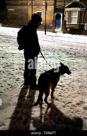 man,walking,dog,in,the,ice,slip,fall,accident,A&E,snow,at,night,winter,weather,cold,storm,blizzard,road,pavement,Cowes, isl eof Wight, England, UK, - Stock Photo