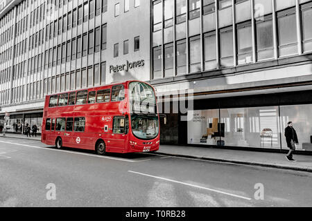 A number 319 London double decker bus on The Kings Road,outside Peter Jones department store in Sloane Square , London SW1 - Stock Photo