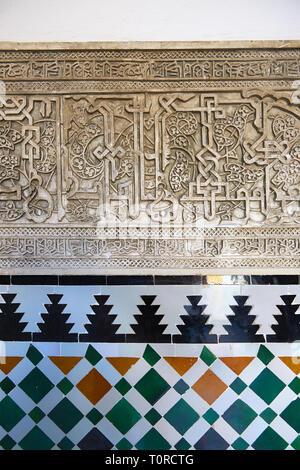 Arabesque Mudjar plaster work and Zillige tiles inside the Vestibule of Don Pedro's Palace, completed in 1366. Alcazar of Seville, Seville, Spain - Stock Photo