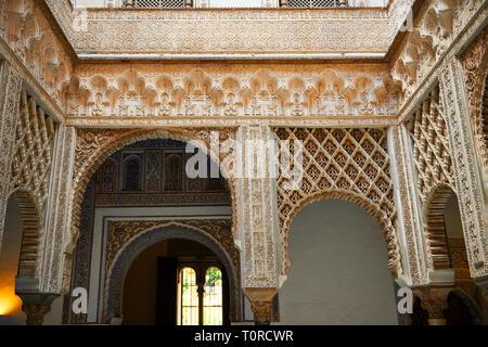Arabesque Mudjar plasterwork of the 12th century Patio de las Muñecas (Courtyard of the Dolls), . Alcazar of Seville, Seville, Spain - Stock Photo