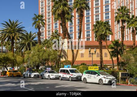 LAS VEGAS, NEVADA, USA - FEBRUARY 2019: Taxis lined up outside the Treasure Island Hotel in Las Vegas. - Stock Photo