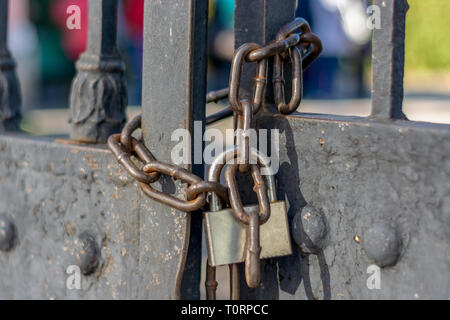 Gates closed on the chain and lock closeup - Stock Photo