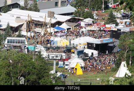 This aerial view shows the Mountain Jam music festival taking place on beautiful summer day on Hunter Mountain, Hunter, New York. - Stock Photo