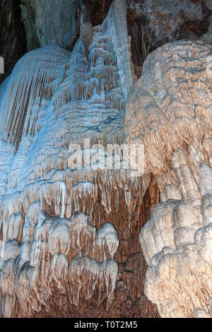 Tubular stalactites, or socalled soda straws along the wall in one of the many caves in Guilin area, Guangxi, China - Stock Photo