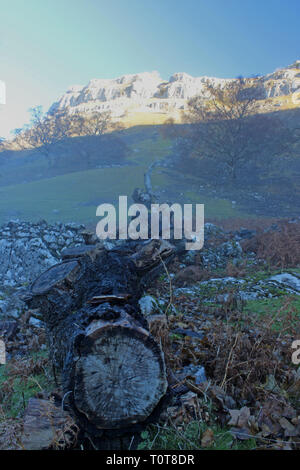 Eglwyseg Mountain limstone crags on a misty morning in November - Stock Photo