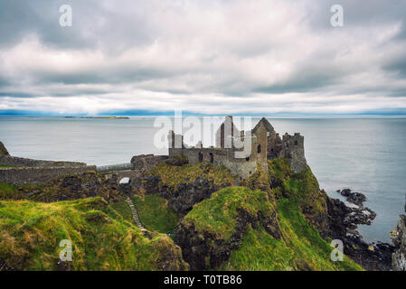 Ruins of the medieval Dunluce Castle in Northern Ireland - Stock Photo