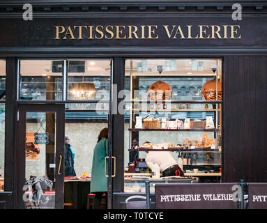 Customer in Patisserie Valerie, Glasgow Central Station concourse, Scotland, UK - Stock Photo