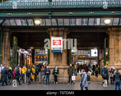 Commuters walking by Victorian entrance of Glasgow Central Station, Scotland, UK - Stock Photo