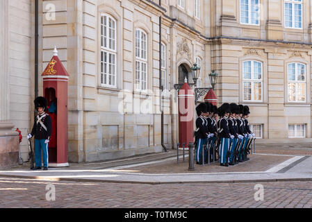 Copenhagen, Denmark - March 19, 2019: the Royal Life Guards (Den Kongelige Livgarde) march from Rosenborg Castle at 11.30 am daily through the streets - Stock Photo