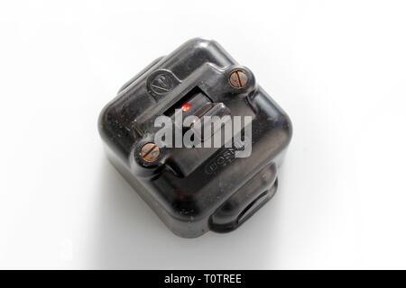 Antique switch on off bakelite, isolated on white background, closeup - Stock Photo