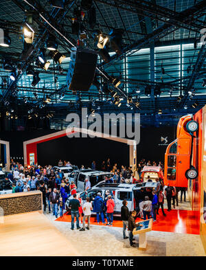 PARIS, FRANCE - OCT 4, 2018: Above view of customers and curious people admiring the Citroen cars range at International car exhibition Mondial Paris Motor Show, models produced by Citroen car maker - Stock Photo
