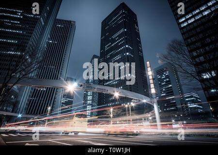 Night view looking up at buildings in Shinjuku, Tokyo, Japan - Stock Photo