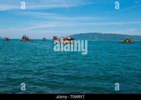 Fishing boats on the beautiful, blue South China Sea in Kota Kinabalu, Sabah, Borneo, Malaysia. - Stock Photo