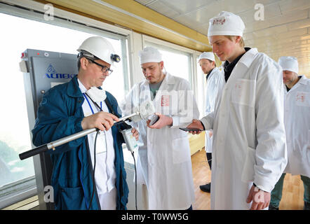 Technician measuring levels of radiation on journalist's equipment after visiting Chernobyl Nuclear Power Plant.April 20, 2018. Chernobyl, Ukraine - Stock Photo