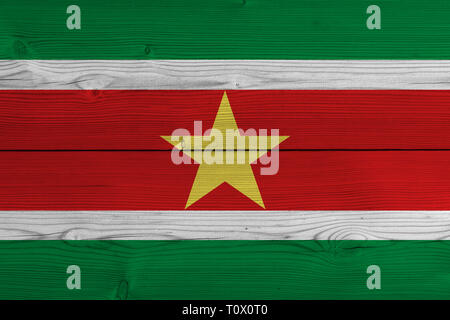 Suriname flag painted on old wood plank - Stock Photo