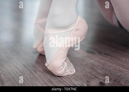 Close up of a feet standing on the toes - Stock Photo