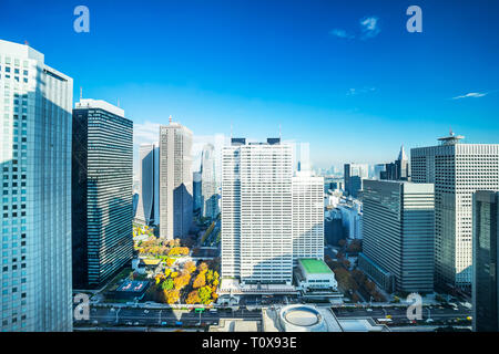 Asia Business concept for real estate and corporate construction - panoramic modern city skyline aerial view of Shinjuku area under blue sky in Tokyo, - Stock Photo