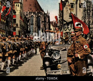 Nazism / National Socialism, party rallies, Nuremberg Rally 5.9. - 10.9.1934, Adolf Hitler during the parade of the Sturmabteilung (SA), Hauptmarkt, Nuremberg, coloured photograph, cigarette card, series 'Die Nachkriegszeit', 1935, military parade, column, columns, car, cars, Nazi salute, Führer, Chancellor of the Reich, Reichskanzler, propaganda, old town, historic city centre, historic city center, Nazi, Nazis, franc, Bavaria, Germany, German Reich, Third Reich, people, 20th century, 1930s, parade, parades, storm battalion, stormtroopers, armed, Additional-Rights-Clearance-Info-Not-Available - Stock Photo