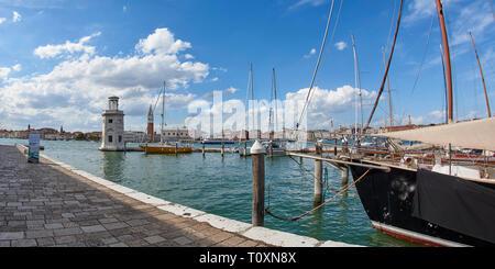 View of the harbour at San Giorgio Maggiore looking across the Canale della Giudecca looking towards San Macro (St Mark's Square) - Stock Photo