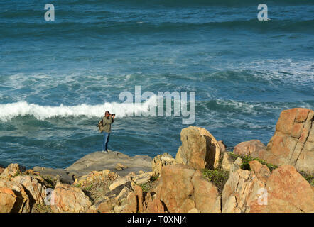 Nha Trang, Vietnam - Jan 27, 2016. A photographer taking pictures of the sea in Nha Trang, Vietnam. Nha Trang is a coastal city on the South Central C - Stock Photo