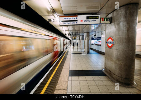 LONDON - MARCH 20, 2019: Train arriving at Embankment at Westminster tube station in London
