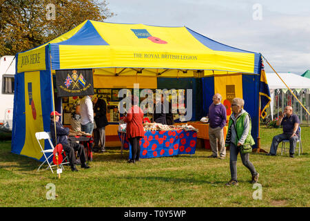 The brightly coloured blue and yellow stall for the Royal British Legion at the 2018 Aylsham Agricultural Show, Norfolk, UK. - Stock Photo