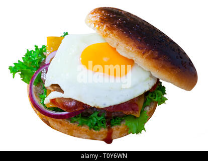 Fresh tasty burger with cheese, lettuce salad, onion and fried egg. Isolated over white background - Stock Photo