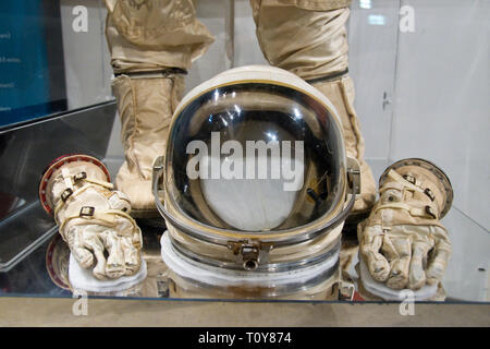 The helmet and gloves of the spacesuit worn on Gemini 8 by astronaut Neil Armstrong, the first man to step on the moon, in the Armstrong Air and Space - Stock Photo