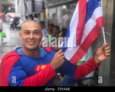 Bangkok, Thailand. 22nd Mar, 2019. The German-Thailander David Pfizenmaier (40) from Waiblingen is on his way as 'Superman' on the streets of Thailand's capital Bangkok to move people to the parliamentary election this Sunday. Five years after the recent military coup, more than 51 million people have been called upon to vote. (to dpa: 'Thai Swabian wants to make people vote as 'Superman') Credit: Christoph Sator/dpa/Alamy Live News - Stock Photo