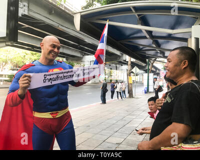 Bangkok, Thailand. 22nd Mar, 2019. The German-Thailander David Pfizenmaier (40) from Waiblingen is on his way as 'Superman' on the streets of Thailand's capital Bangkok to move people to the parliamentary election this Sunday. His banner says, 'If you love Thailand, go vote.' Five years after the recent military coup, more than 51 million people have been called upon to vote. (to dpa: 'Thai Swabian wants to make people vote as 'Superman') Credit: Christoph Sator/dpa/Alamy Live News - Stock Photo