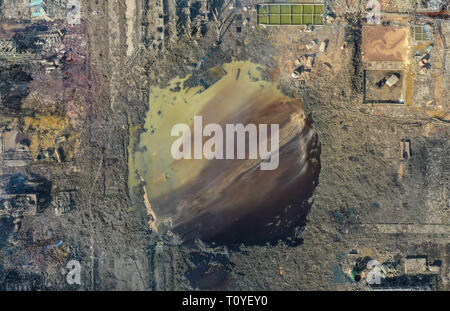Xiangshui. 22nd Mar, 2019. Aerial photo taken on March 22, 2019 shows the site of an explosion at a chemical industrial park in Xiangshui County of Yancheng, east China's Jiangsu Province. Thousands of firefighters and medical workers and hundreds of ambulances and fire trucks have joined an all-out rescue after an explosion rocked a chemical plant Thursday in an industrial park in Xiangshui County. The blast has killed at least 47 people and injured hundreds of others, 90 of them seriously. Credit: Li Bo/Xinhua/Alamy Live News - Stock Photo