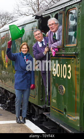 Swanage, Dorset, UK. 22nd Mar 2019. Crowds flock to Swanage Railway to see the Flying Scotsman thanks to the National Railway Museum who enabled the historic visit to take place. During the next five days she will haul trains between Swanage, Corfe Castle and Norden. Penny Vaudoyer, the daughter of Alan Pegler, waves off the first trip. Credit: Carolyn Jenkins/Alamy Live News - Stock Photo