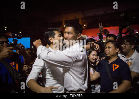 Secretary-general of Future Forward Party Piyabutr Saengkanokkul and Future Forward Party Leader Thanathorn Juangroongruangkit hug themselves during the Future Forward Party latest rally before the Thai General Election at the Thai-Japanese Stadium in Bangkok. The country will hold the general election on March 24, 2019, five years after the May 2014 military coup by Junta chief Prayut Chan-o-cha. - Stock Photo