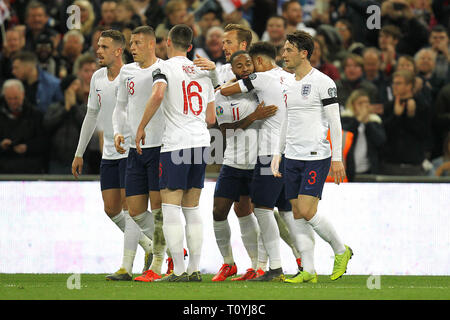 London, UK. 22nd Mar, 2019. England celebrate after Raheem Sterling (3rd R) completed his hat-trick to make it 4-0 during the UEFA Euro 2020 Qualifying Group A match between England and Czech Republic at Wembley Stadium on March 22nd 2019 in London, England. (Photo by Matt Bradshaw/phcimages.com) Credit: PHC Images/Alamy Live News - Stock Photo