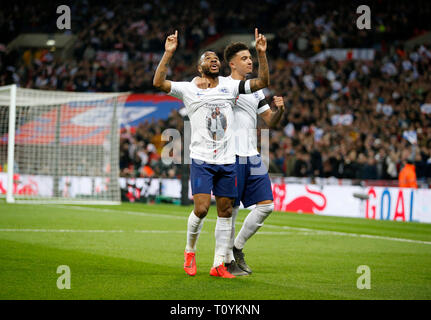 London, UK. 22nd Mar, 2019. England's Raheem Sterling (L) celebrates scoring during the Euro 2020 qualifying Group A match between England and Czech Republic at Wembley Stadium in London, Britain on March 22, 2019. England won 5-0. FOR EDITORIAL USE ONLY. NOT FOR SALE FOR MARKETING OR ADVERTISING CAMPAIGNS. NO USE WITH UNAUTHORIZED AUDIO, VIDEO, DATA, FIXTURE LISTS, CLUB/LEAGUE LOGOS OR 'LIVE' SERVICES. ONLINE IN-MATCH USE LIMITED TO 45 IMAGES, NO VIDEO EMULATION. NO USE IN BETTING, GAMES OR SINGLE CLUB/LEAGUE/PLAYER PUBLICATIONS. Credit: Matthew Impey/Xinhua/Alamy Live News - Stock Photo