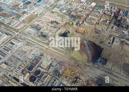Beijing, China. 22nd Mar, 2019. Aerial photo taken on March 22, 2019 shows the site of an explosion at a chemical industrial park in Xiangshui County of Yancheng, east China's Jiangsu Province. The death toll from an explosion in a chemical plant in east China's Jiangsu Province has risen to 64 as of 7 a.m. Saturday, authorities said. The explosion happened at about 2:48 p.m. Thursday following a fire that broke out in a plant, owned by Jiangsu Tianjiayi Chemical Co. Ltd., in a chemical industrial park in Xiangshui County in the city of Yancheng. Credit: Ji Chunpeng/Xinhua/Alamy Live News - Stock Photo