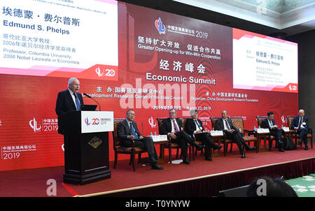 (190323) -- BEIJING, March 23, 2019 (Xinhua) -- Edmund S. Phelps (1st L), professor of Columbia University and Nobel Prize laureate, speaks during the Economic Summit of China Development Forum 2019 in Beijing, capital of China, March 23, 2019. The three-day China Development Forum, which kicked off Saturday, will focus on key issues such as the supply-side structural reform, new measures of proactive fiscal policy, and the opening-up of the financial sector and financial stability. More than 50 officials from the Chinese central government's departments and over 150 overseas delegates wil - Stock Photo