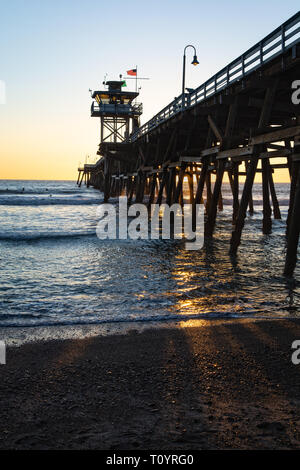 The image shows the pier as well as the wooden structure underneath the pier. It was built in 1928 with a length of about 395 meters. - Stock Photo