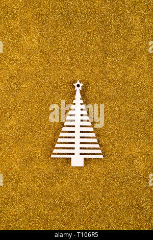 Wooden Christmas tree shape on golden glitter background - Stock Photo