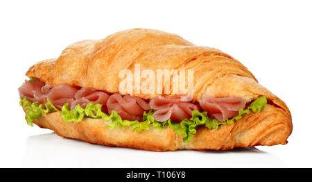 Big croissant with green salad and pork meat on white background - Stock Photo