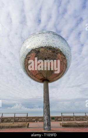 BLACKPOOL, UK - October 21, 2016: Giant mirror ball is an art installation on the south shore of Blackpool, UK. - Stock Photo