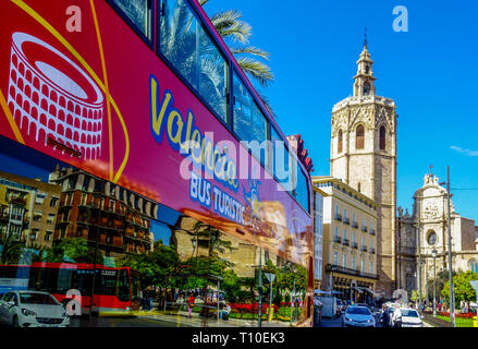 Valencia, Turistic bus on Plaza de la Reina Square, Bell Tower, Micalet, Miguelete, Valencia, Cathedral Tower, Spain - Stock Photo