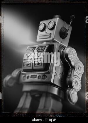 black and white image of toy tin robot - Stock Photo