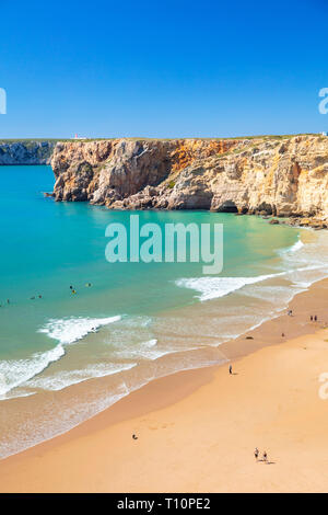People walking and learning to surf on Beliche beach Sagres Praia do Beliche Sagres Algarve Portugal EU Europe - Stock Photo